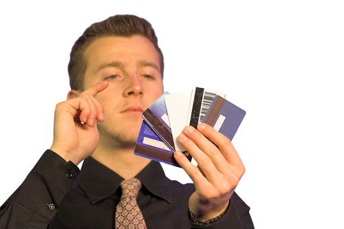 business man chossing what credit card to pay with
